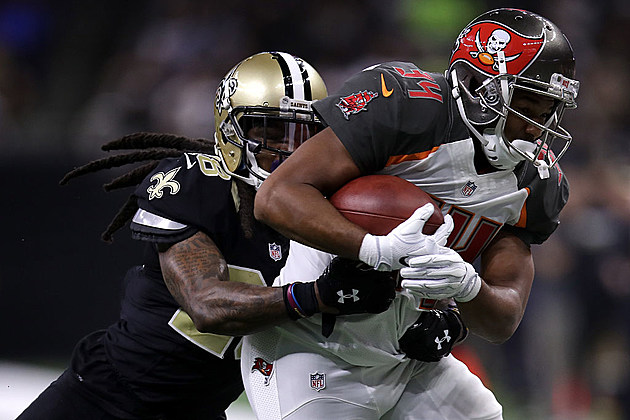 Charles Sims #34 of the Tampa Bay Buccaneers is tackled by  B.W. Webb #28 of the New Orleans Saints